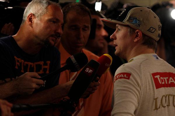 Yas Marina Circuit, Abu Dhabi, United Arab Emirates Sunday 4th November 2012. Kimi Raikkonen, Lotus GP, talks to the media after victory. World Copyright: Andrew Ferraro/  ref: Digital Image _Q0C2787
