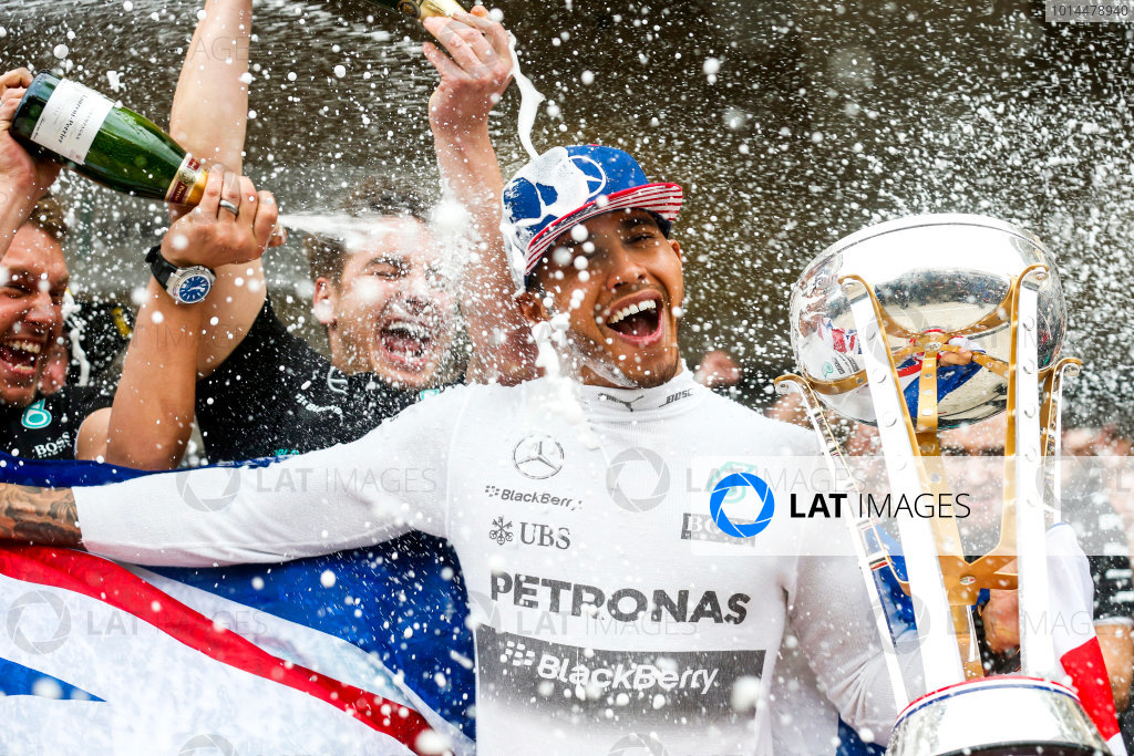 Circuit of the Americas, Austin, Texas, United States of America.  Sunday 25 October 2015. Lewis Hamilton, Mercedes AMG, 1st Position, gets a Champagne soaking from his team after securing a third World Drivers Championship victory. World Copyright: Alastair Staley/LAT Photographic ref: Digital Image _79P4353