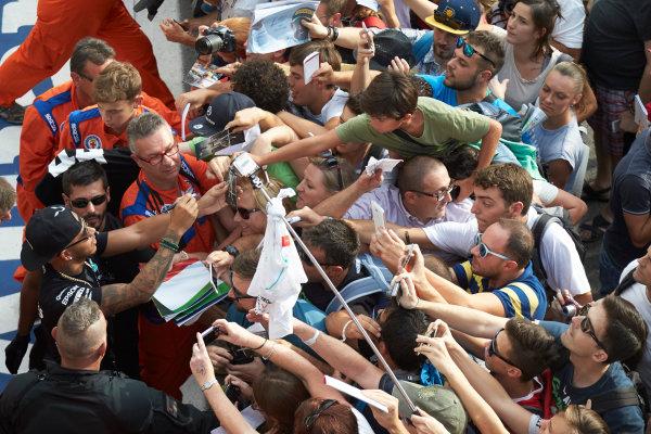 Autodromo Nazionale di Monza, Monza, Italy. Thursday 3 September 2015. Lewis Hamilton, Mercedes AMG, signs autographs for fans. World Copyright: Steve Etherington/LAT Photographic ref: Digital Image SNE23492