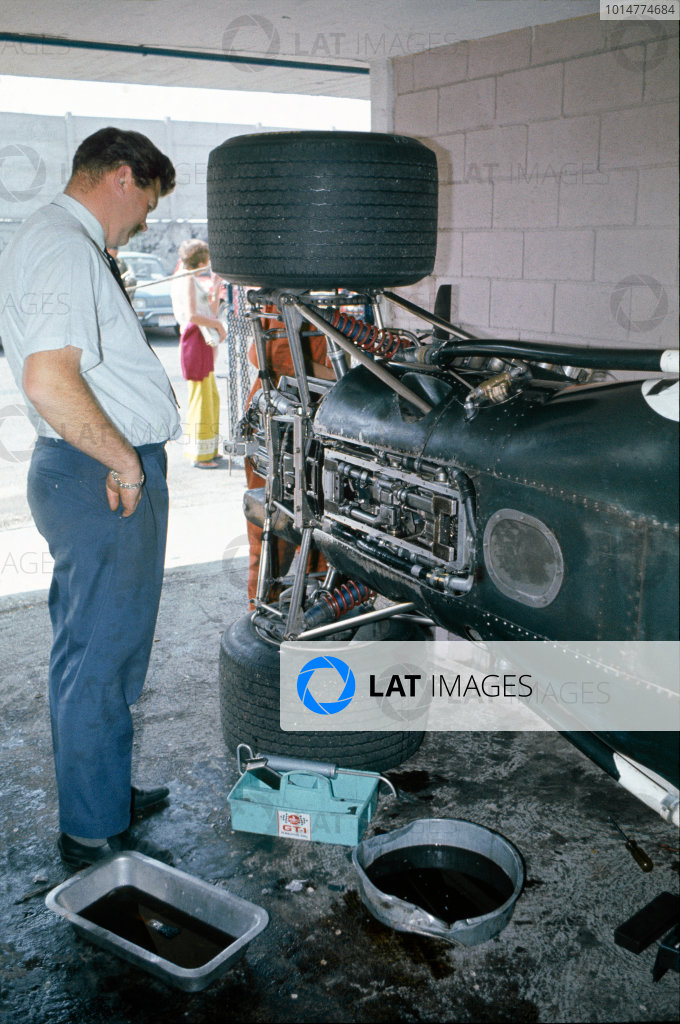 1969 Formula One World Championship. Tim Parnell stands next to the BRM P138, in the pits, portrait.  World Copyright: LAT Photographic. Ref:  Colour Transparency.