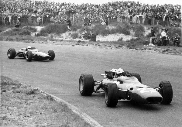 1967 Dutch Grand Prix.Zandvoort, Holland. 4 June 1967.Ludovico Scarfiotti, Ferrari 312, 6th position, leads Chris Irwin, Lotus 33-BRM, 7th position, action.World Copyright: LAT PhotographicRef: Autosport b&w print