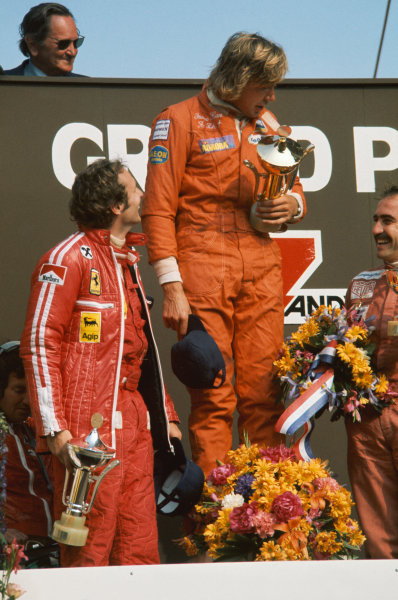 Zandvoort, Holland. 20 - 22 June 1975. James Hunt (Hesketh 308-Ford), 1st position, with Niki Lauda (Ferrari 312T), 2nd position and Clay Regazzoni (Ferrari 312T),3rd position on the podium, portrait.  World Copyright: LAT Photographic. Ref:  75 HOL 42.