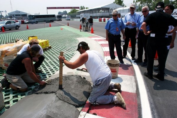 Charlie Whiting (GBR) FIA Delegate and Herbie Blash (GBR) FIA oversee the re-cementing of the final chicane.