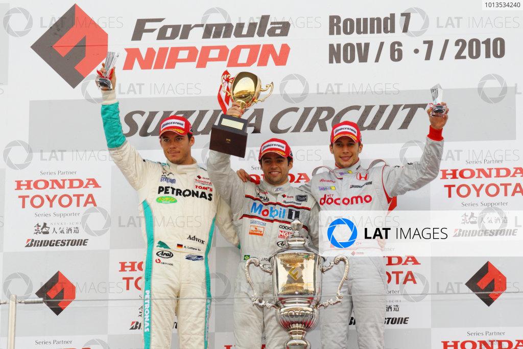 Rd 7 Suzuka, Japan. 6th - 7th November 2010.Race2, Winner Joao Paulo de Oliveira ( #19 Mobil1 TEAM IMPUL ) 2nd position Andre Lotterer ( #36 PETRONAS TEAM TOM'S ) 3rd position Takashi Kogure ( #32 NAKAJIMA RACING ) podium.World Copyright: Yasushi Ishihara/LAT Photographic.Ref: 2010FN_R7_024.