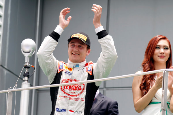 2013 GP2 Series. Round 1.  Sepang, Kuala Lumpur, Malaysia. 24th March 2013.  Sunday Race.  Stefano Coletti (MON, Rapax) celebrates his victory on the podium.  World Copyright: Alastair Staley/GP2 Series Media Service.  ref: _A8C6241