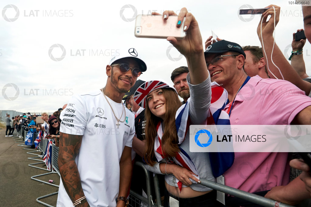 Silverstone, Northamptonshire, UK.  Sunday 16 July 2017. Lewis Hamilton, Mercedes AMG, signs autographs for fans. World Copyright: Steve Etherington/LAT Images  ref: Digital Image SNE10725