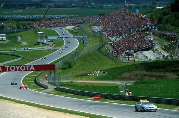 The field process around the circuit behind the Mercedes safety car. The safety car was brought out on two occasions throughout the race.Austrian Grand Prix, Rd6, A1-Ring, Austria. 13 May 2002.BEST IMAGE