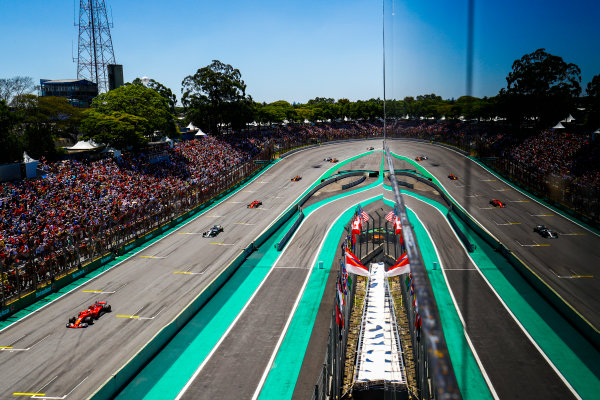 Interlagos, Sao Paulo, Brazil. Sunday 12 November 2017. Sebastian Vettel, Ferrari SF70H, leads Valtteri Bottas, Mercedes F1 W08 EQ Power+, Kimi Raikkonen, Ferrari SF70H, Max Verstappen, Red Bull Racing RB13 TAG Heuer, Fernando Alonso, McLaren MCL32 Honda, and Felipe Massa, Williams FW40 Mercedes. World Copyright: Steven Tee/LAT Images  ref: Digital Image _O3I0681