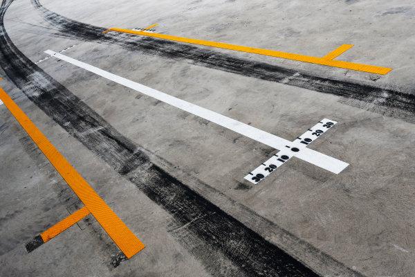 Interlagos, Sao Paulo, Brazil. Saturday 8 November 2014. Tyre marks in the pit lane. World Copyright: Steven Tee/LAT Photographic. ref: Digital Image _X0W7010