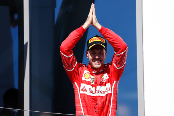 Hungaroring, Budapest, Hungary.  Sunday 30 July 2017. Sebastian Vettel, Ferrari, celebrates his victory on the podium. World Copyright: Glenn Dunbar/LAT Images  ref: Digital Image _X4I2296