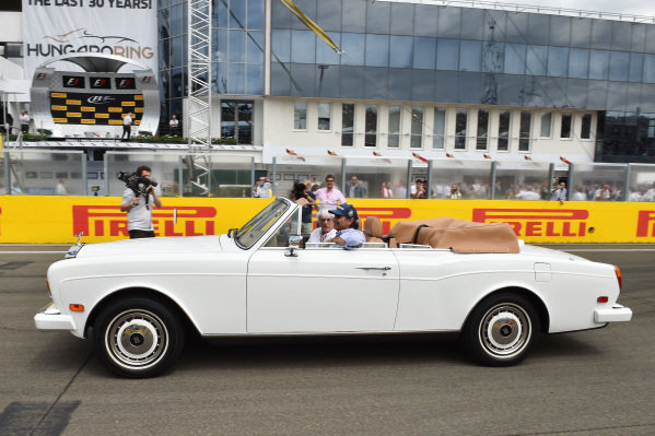Nelson Piquet (BRA) and Bernie Ecclestone (GBR) CEO Formula One Group (FOM) in a Rolls Royce on the grid on the grid at Formula One World Championship, Rd10, Hungarian Grand Prix, Race, Hungaroring, Hungary, Sunday 26 July 2015.
