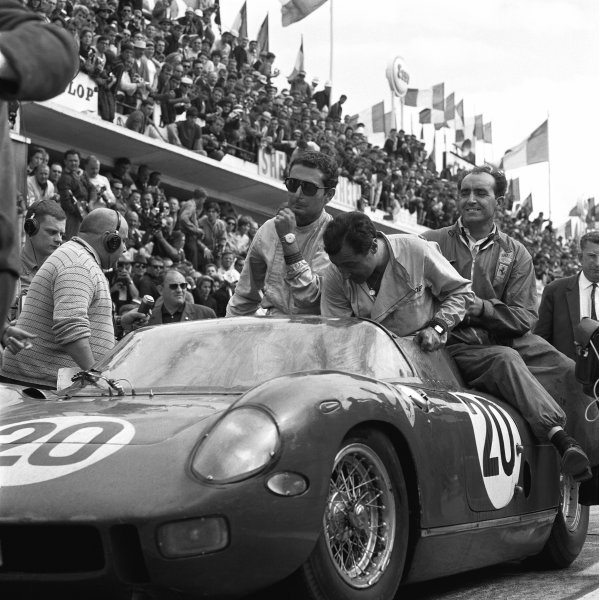 Le Mans, France. 20th - 21st June 1964. Nini Vaccarella/Jean Guichet (Ferrari 275 P), 1st position, on their way to the podium, portrait. World Copyright: LAT Photographic. Ref: 3/1271