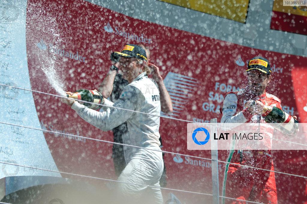 Silverstone, Northamptonshire, England 30th June 2013 Nico Rosberg, Mercedes AMG, 1st position, Mark Webber, Red Bull Racing, 2nd position, and Fernando Alonso, Ferrari, 3rd position, celebrate on the podium World Copyright: Chris Bird/  ref: Digital Image _CJB6798