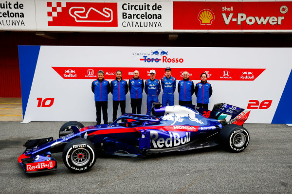 Circuit de Catalunya, Barcelona, Spain. Monday 26 February 2018. Franz Tost, Team Principal, Toro Rosso, Pierre Gasly, Toro Rosso, and Brendon Hartley, Toro Rosso, unveil the Toro Rosso STR13 Honda, with other members of the team. World Copyright: Andy Hone/LAT Images ref: Digital Image _ONY7195