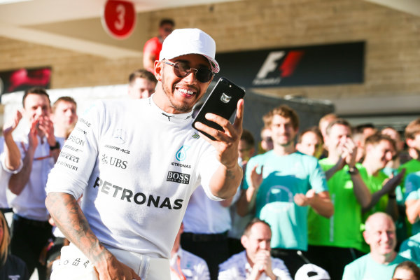 Circuit of the Americas, Austin, Texas, United States of America. Sunday 22 October 2017. Lewis Hamilton, Mercedes AMG, 1st Position, celebrates winning the race and the Constructors title with his team. World Copyright: Charles Coates/LAT Images  ref: Digital Image AN7T2316