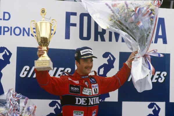 Paul Ricard, France. 4-6 July 1986. Nigel Mansell (Williams Honda) 1st position, on the podium. Portrait. Ref: 86 FRA 07. World Copyright - LAT Photographic
