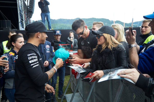 Red Bull Ring, Spielberg, Austria. Saturday 20 June 2015. Lewis Hamilton, Mercedes AMG, signs autographs for fans. World Copyright: Steve Etherington/LAT Photographic. ref: Digital Image SNE24270