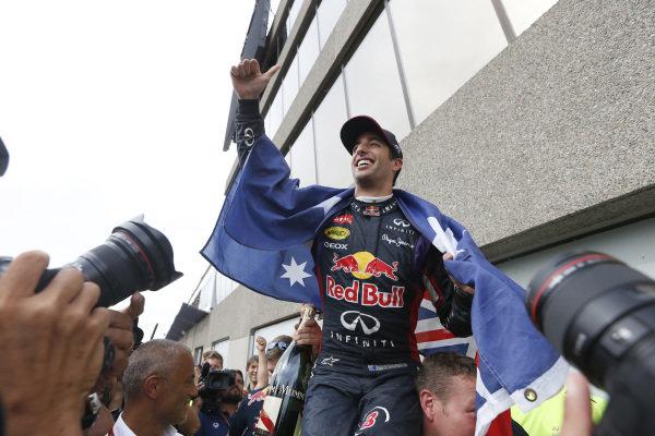 Circuit Gilles Villeneuve, Montreal, Canada. Sunday 8 June 2014. Daniel Ricciardo, Red Bull Racing, 1st Position, celebrates with his team. World Copyright: Alastair Staley/LAT Photographic. ref: Digital Image _79P1314