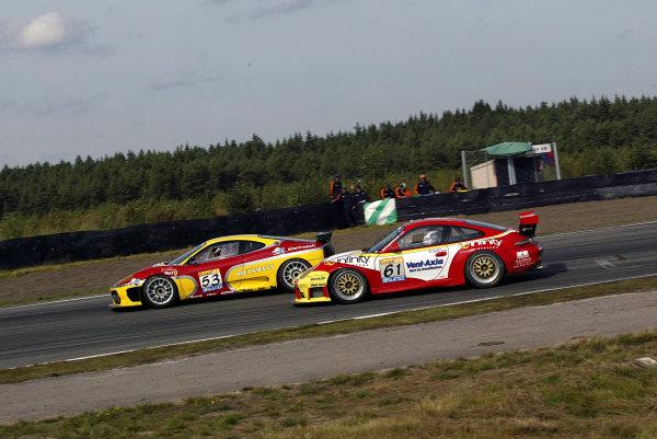 2003 FIA GT ChampionshipAnderstorp, Sweden. 6th - 7th September 2003.Kutemann/Gosse (Ferrari 360 Modena) leads Sugden/Collard (Porsche 996 GT3-RS), action.World Copyright: Photo4/LAT Photographicref: Digital Image Only