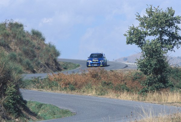 2003 World Rally ChampionshipRally of San Remo, Italy. 2nd - 5th October 2003.Tommi Makinen / Kaj Lindstrom, Subaru Impreza WRC 2003. Twisty Road Section, Tree. Action.World Copyright: McKLEIN/LATref: 35mm Image WRCSANREMO11 jpg