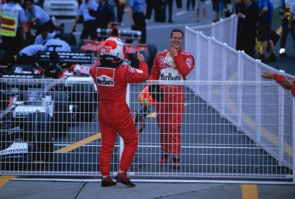 2003 Japanese Grand PrixSuzuka, Japan. 10th - 112th October 2003.Race winner Rubens Barrichello, Ferrari F2003 GA, celebrates with Michael Schumacher, Ferrari F2003 GA, who took his 6th World Championship with his 8th place finish.World Copyright: Lorenzo Bellanca / LAT Photographic ref: 35mm Image 03JAP24