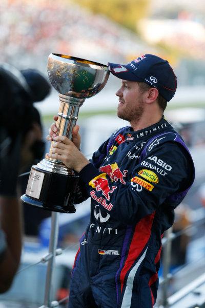 Suzuka Circuit, Suzuka, Japan.  Sunday 13th October 2013. Sebastian Vettel, Red Bull Racing, lifts his trophy on the podium.  World Copyright: Steven Tee/LAT Photographic  ref: Digital Image _C3I1215