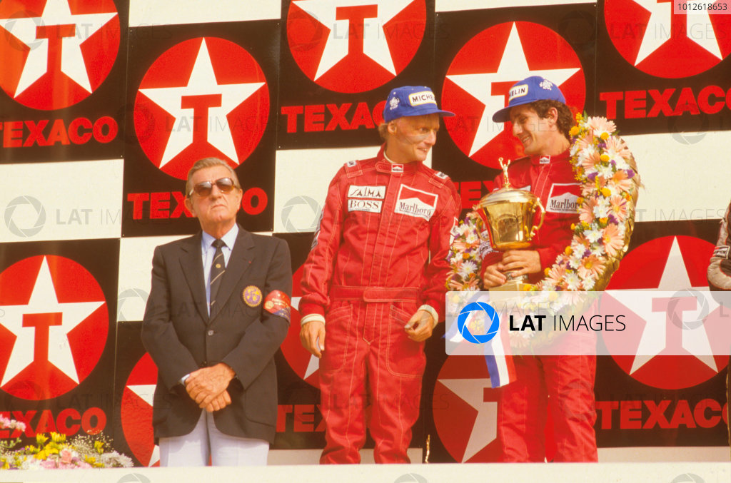 Zandvoort, Holland.24-26 August 1984.Alain Prost, 1st position with teammate Niki Lauda, 2nd position (both McLaren TAG Porsche) on the podium with FIA President Jean-Marie Balestre. Ref-84 HOL 09.World Copyright - LAT Photographic