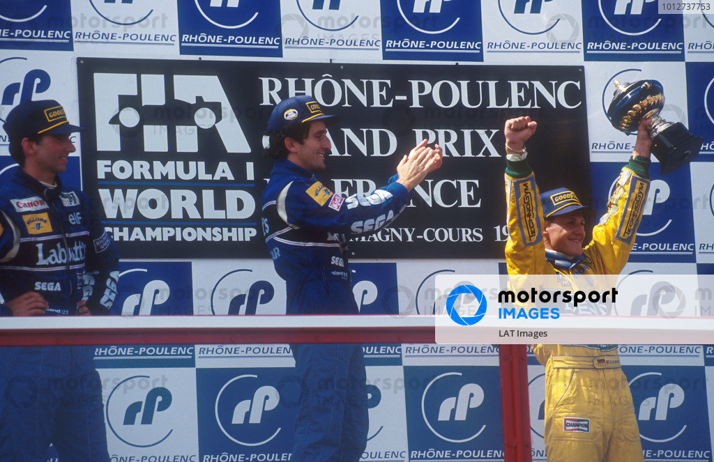 1993 French Grand Prix.Magny-Cours, France.2-4 July 1993.Alain Prost (Williams Renault) 1st position, Damon Hill (Williams Renault) 2nd position and Michael Schumacher (Benetton Ford) 3rd position on the podium. 