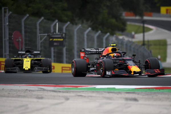 Pierre Gasly, Red Bull Racing RB15, leads Daniel Ricciardo, Renault R.S.19