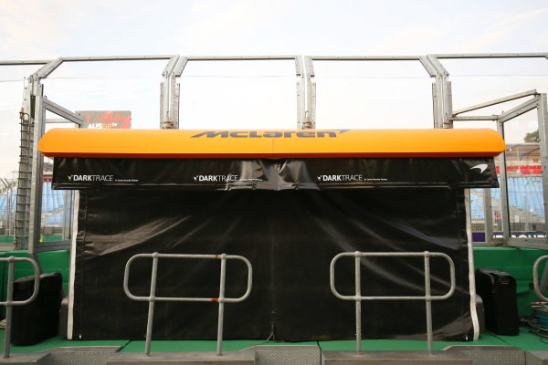 The McLaren pit wall stand