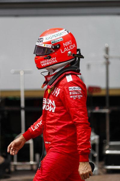 Sebastian Vettel, Ferrari, walks back to his pit garage after an accident in FP3