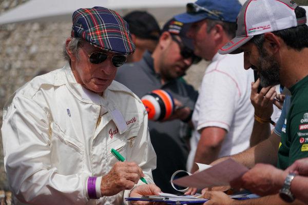 Jackie Stewart signs autographs.