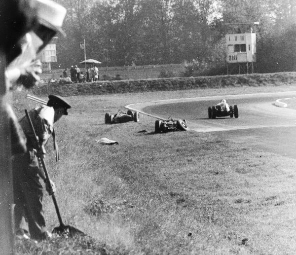 Monza, Italy. 10 September 1961. The aftermath of the accident between Wolfgang von Trips (Ferrari Dino 156) and Jim Clark (Lotus 21-Climax). Von Trips suffered fatal injuries in the accident. World Copyright - LAT Photographic