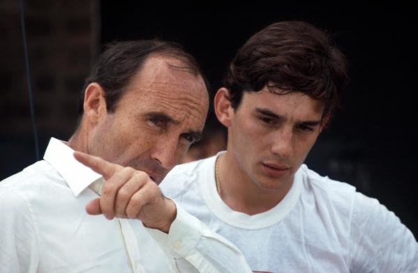 Ayrton Senna (BRA) (right) discusses his first run in the Williams FW08C with team owner Frank Williams (left). Formula One Testing, Donington Park, England, 19 July 1983.