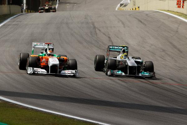 Interlagos, Sao Paulo, Brazil.27th November 2011.Adrian Sutil, Sahara Force India VJM04 Mercedes battles with Nico Rosberg, Mercedes GP W02. Action.World Copyright:Andrew Ferraro/LAT Photographicref: Digital Image _Q0C6309